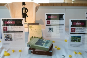 Silent Auction tables featuring a prize package inspired by Pride and Prejudice
