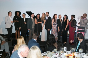 "The creators and Broadway cast of In Transit perform a special version of ""We Are Home"" to honor Janet B. Rosen and Marvin Rosen"