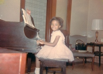 Sharon at the baby grand piano in her apartment in the library.